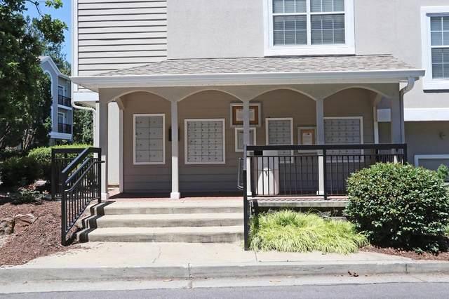 4250 River Green Drive NW #404, Atlanta, GA 30327 (MLS #9043920) :: The Heyl Group at Keller Williams
