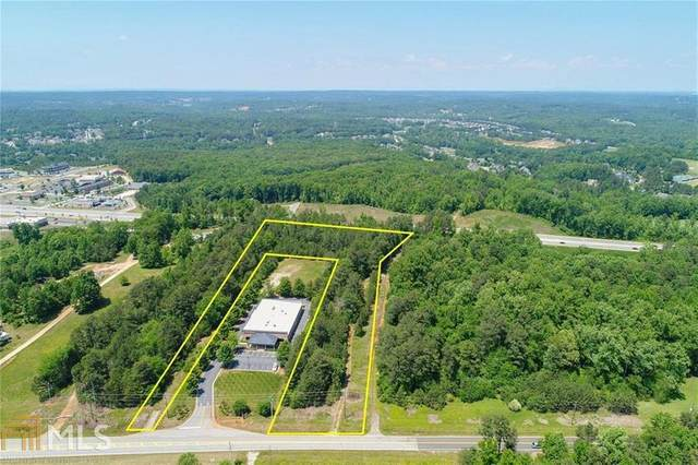 5374 Thompson Mill Rd, Hoschton, GA 30548 (MLS #8911339) :: Rettro Group