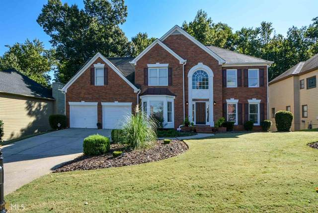 7066 Hunters Ridge, Woodstock, GA 30189 (MLS #8870538) :: Tim Stout and Associates