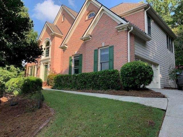 1915 Woods River Lane, Duluth, GA 30097 (MLS #9028070) :: The Realty Queen & Team