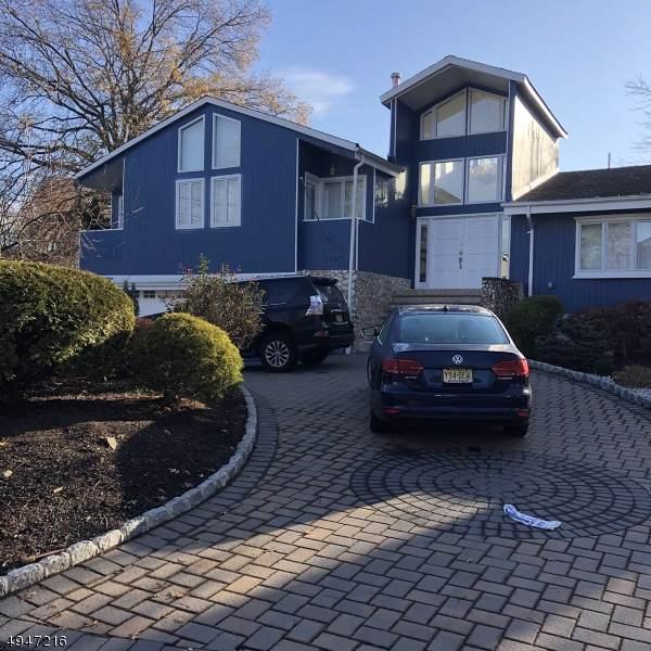 210 Little Falls Rd, Fairfield Twp., NJ 07004 (#3602849) :: NJJoe Group at Keller Williams Park Views Realty