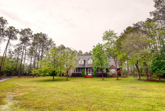 14294 Woodland Hills Dr, Biloxi, MS 39532 (MLS #373945) :: Coastal Realty Group