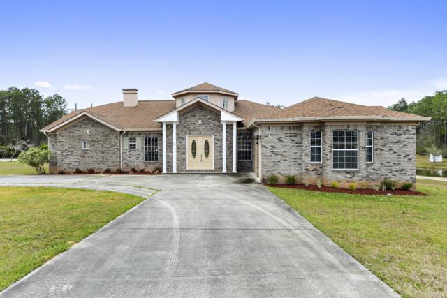 14135 Woodland Hills Dr, Biloxi, MS 39532 (MLS #339506) :: Coastal Realty Group