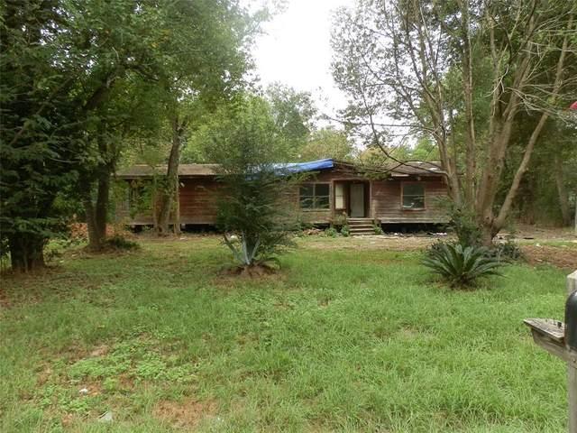 403 S Pine Circle, Pinehurst, TX 77362 (MLS #10758741) :: Texas Home Shop Realty