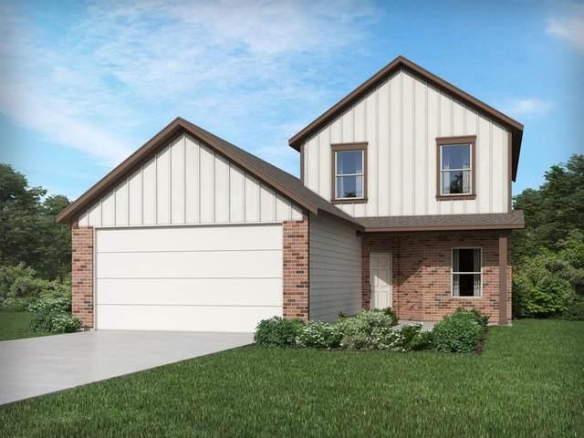 14925 Fannin Road, Willis, TX 77378 (MLS #13143465) :: My BCS Home Real Estate Group