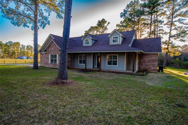 27 Woodland Hills Drive, Huntsville, TX 77320 (MLS #13617573) :: Caskey Realty
