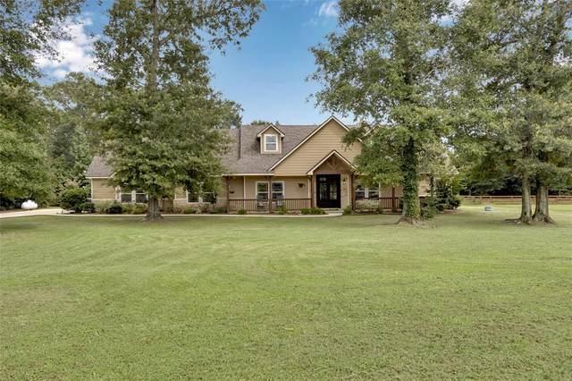 9110 Bush Buck Lane, Conroe, TX 77303 (MLS #18580483) :: Michele Harmon Team
