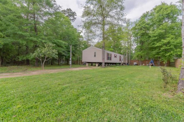 25561 Spruce Lane, Cleveland, TX 77328 (MLS #21716303) :: Texas Home Shop Realty