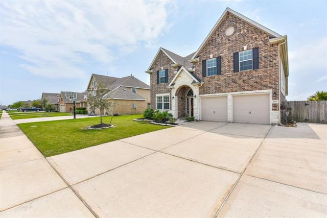 9711 Wincrest Drive, Mont Belvieu, TX 77523 (MLS #22262546) :: The SOLD by George Team