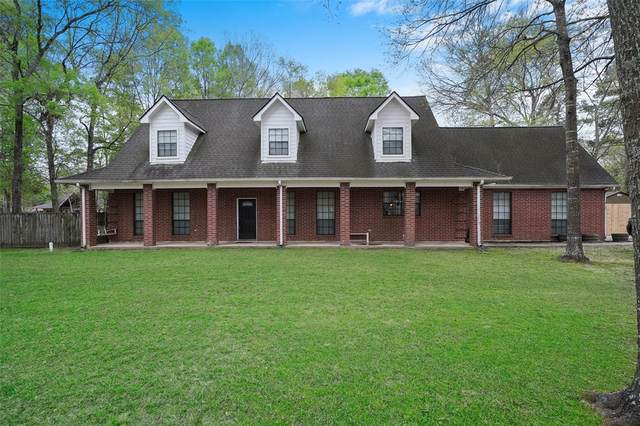 222 Magnolia Bend, New Caney, TX 77357 (MLS #22779694) :: The Sansone Group