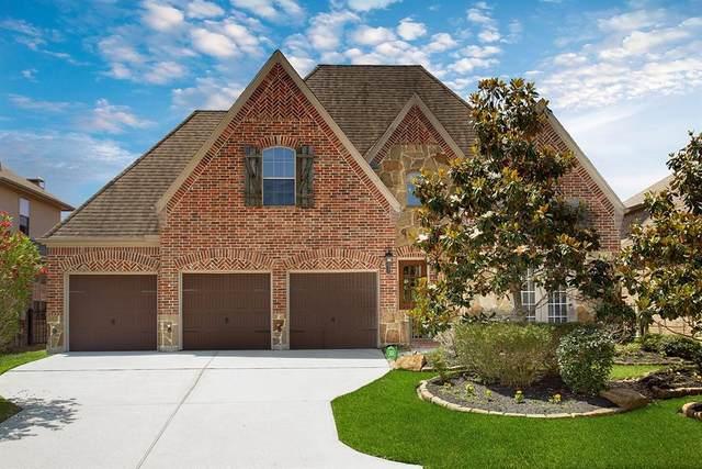 11 Kayak Ridge Drive, The Woodlands, TX 77389 (MLS #22933290) :: Caskey Realty