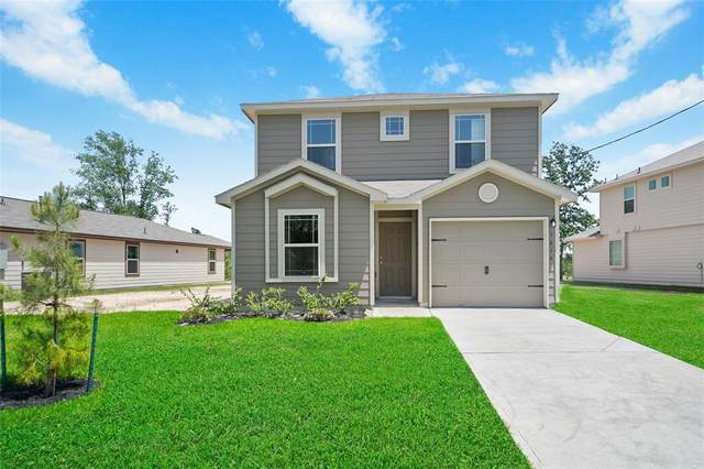 1614 Road 5102, Cleveland, TX 77327 (MLS #23510003) :: The SOLD by George Team