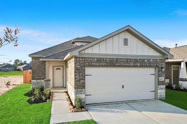 14211 Grand Hills Drive, Conroe, TX 77303 (MLS #24530112) :: Michele Harmon Team