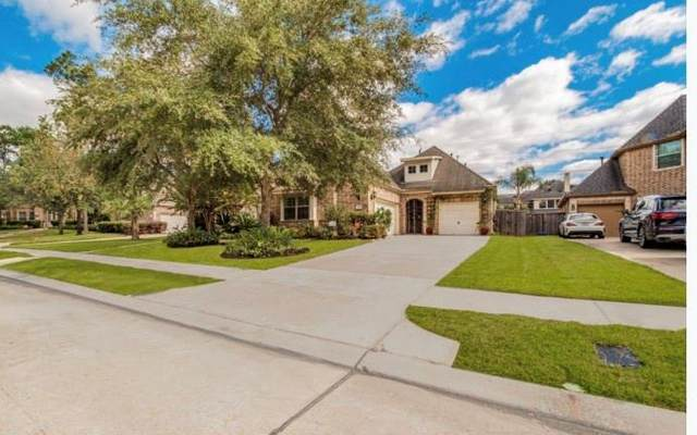 14326 Windy Crossing Lane, Humble, TX 77396 (MLS #25870313) :: The SOLD by George Team