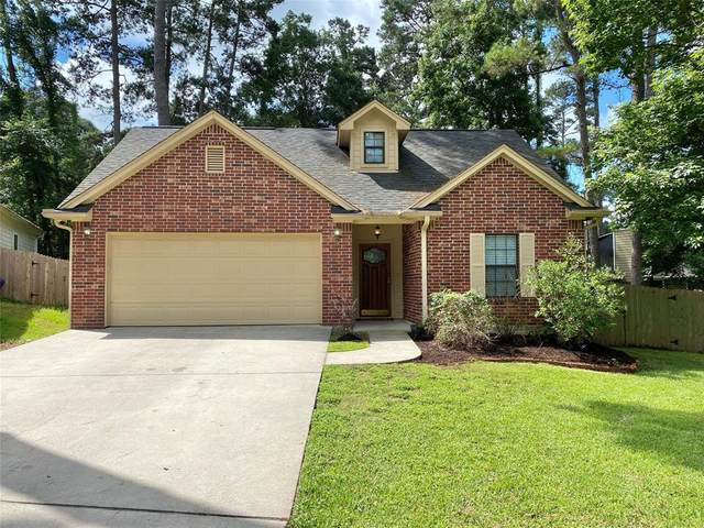 13917 Dolphin Drive, Willis, TX 77318 (MLS #26254516) :: The SOLD by George Team