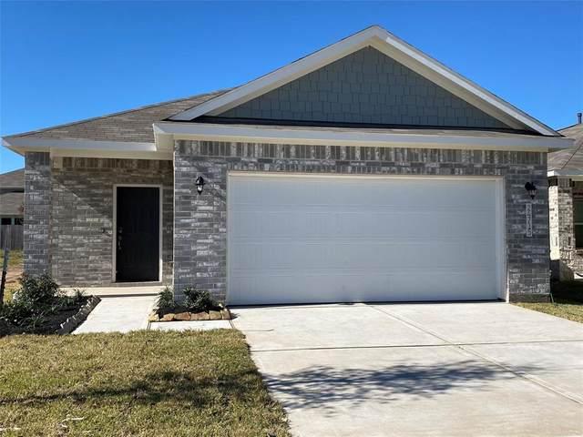 911 Redinger Ridge Drive, Huffman, TX 77336 (MLS #2679133) :: The Freund Group