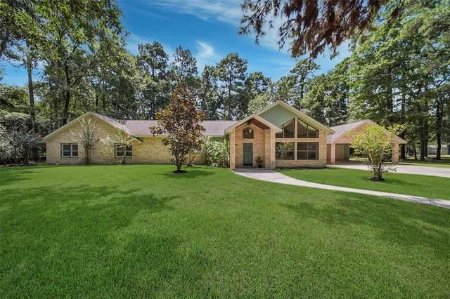 9203 Woodlane Boulevard, Magnolia, TX 77354 (MLS #27366497) :: The SOLD by George Team