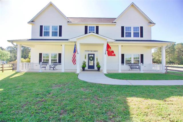 21839 Stillwater Boulevard, Montgomery, TX 77316 (MLS #27820050) :: Texas Home Shop Realty