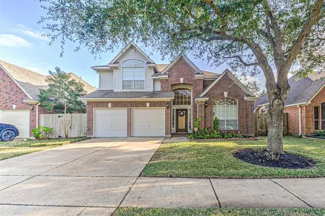 14131 Lake Trail Drive, Sugar Land, TX 77498 (MLS #28736579) :: Caskey Realty