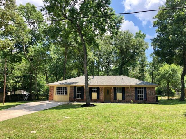 10750 Royal Forest Drive, Conroe, TX 77303 (MLS #29233245) :: Magnolia Realty