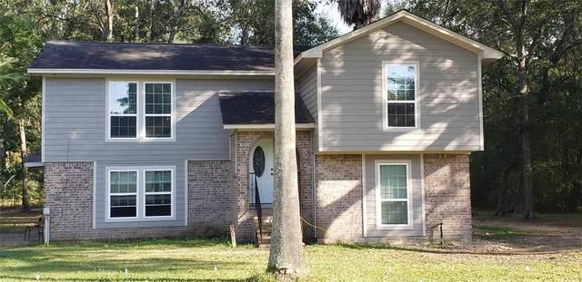5047 Wood Loop, Conroe, TX 77306 (MLS #30400270) :: The Home Branch