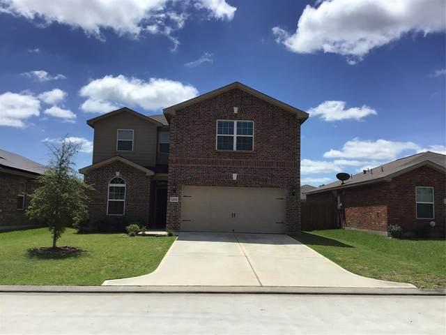 12011 Fairquarter Lane, Pinehurst, TX 77362 (MLS #30414342) :: Christy Buck Team