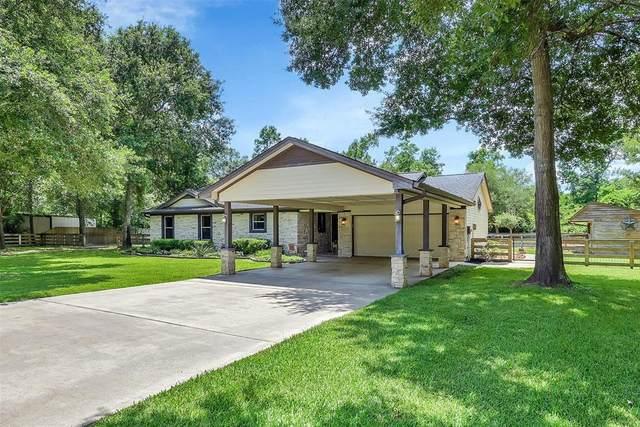 142 Sentinel Oaks, Pinehurst, TX 77362 (MLS #30963934) :: Parodi Group Real Estate