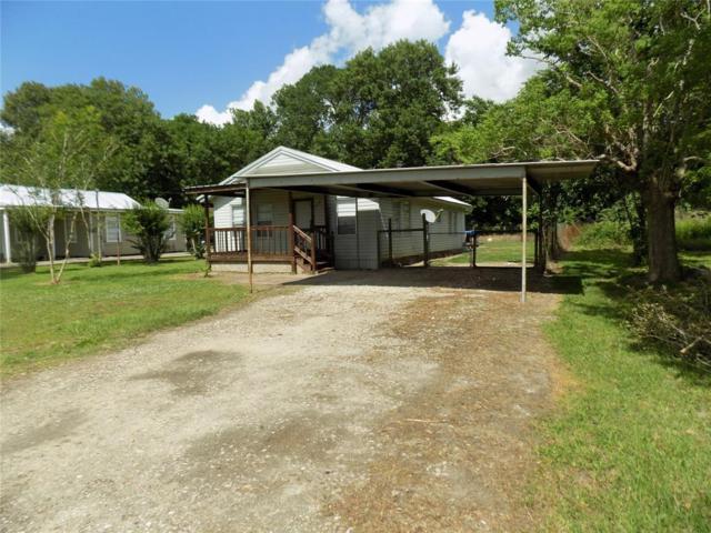 9750 Highway 146 N, Hardin, TX 77575 (MLS #3339009) :: Texas Home Shop Realty