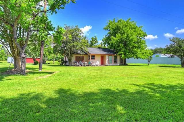 21517 Hufsmith Kohrville Road, Tomball, TX 77375 (#34196460) :: ORO Realty