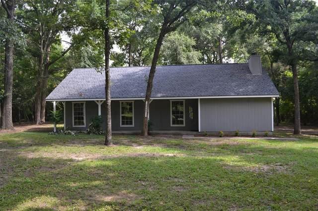 7402 Ponderosa Trail, Montgomery, TX 77316 (MLS #35376118) :: The Property Guys