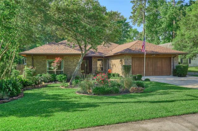 27 Greentree Lane, Conroe, TX 77304 (MLS #36716422) :: The SOLD by George Team