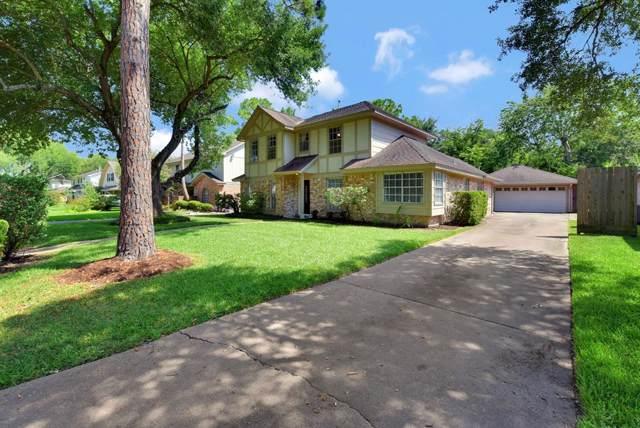 14111 Wickersham Ln, Houston, TX 77077 (MLS #36971625) :: The SOLD by George Team