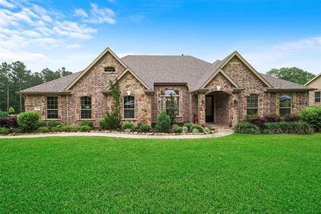 9542 Longmire Oaks Drive, Conroe, TX 77304 (MLS #37347795) :: The SOLD by George Team