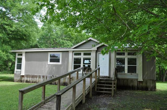 58 Creek Point, Huntsville, TX 77320 (MLS #3761186) :: The SOLD by George Team