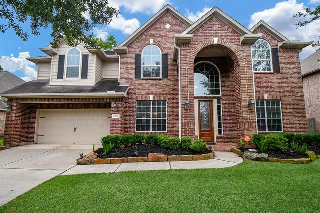 14710 Castle Cove Lane, Houston, TX 77044 (MLS #38366546) :: Michele Harmon Team
