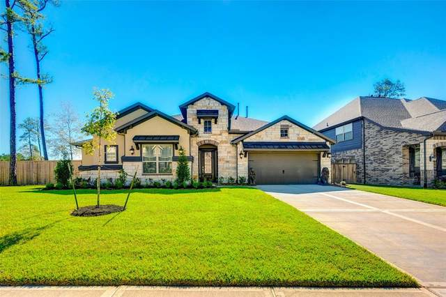 926 Falcon Hollow Lane, Pinehurst, TX 77362 (MLS #39082121) :: Rachel Lee Realtor