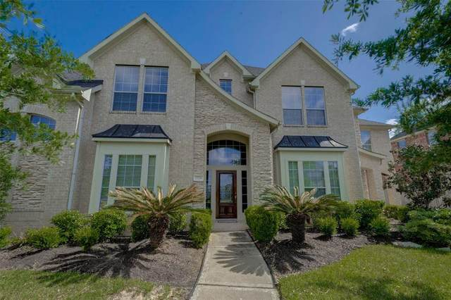 7726 Courtney Manor Lane, Katy, TX 77494 (MLS #39908712) :: The SOLD by George Team