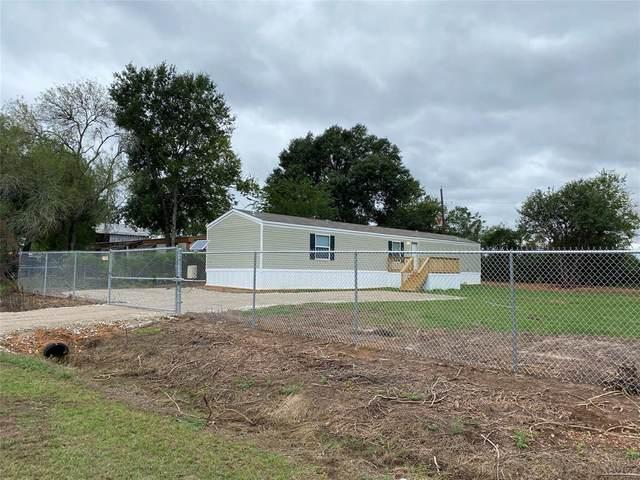 602 N Pine Hill Street, Pinehurst, TX 77362 (MLS #40153145) :: Texas Home Shop Realty