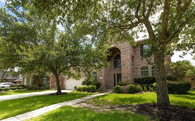 14619 Woodside Crossing Lane, Humble, TX 77396 (MLS #40976979) :: The SOLD by George Team