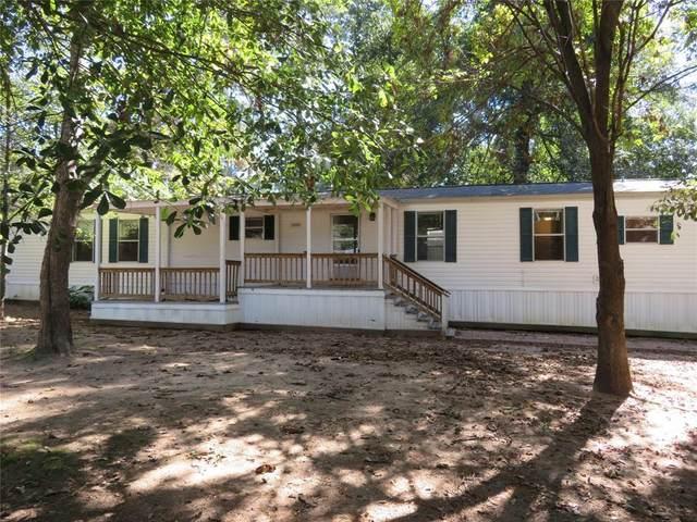 14254 E Ravine Run, Willis, TX 77318 (MLS #41240263) :: Caskey Realty