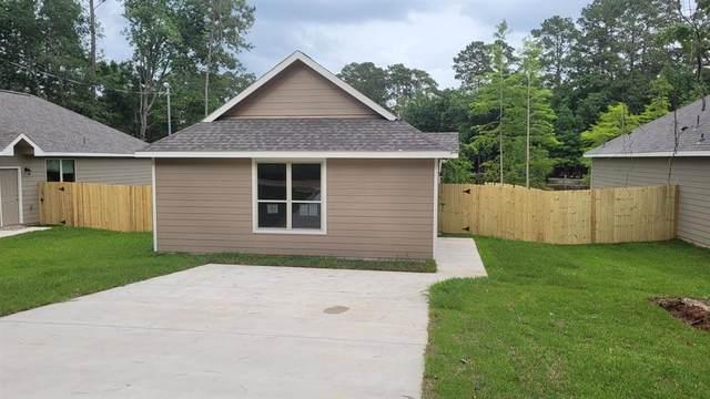 15063 Arrowhead Loop East, Willis, TX 77378 (MLS #43260252) :: The Property Guys
