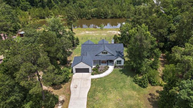 11523 Oak Springs Drive, Willis, TX 77378 (MLS #44018029) :: Texas Home Shop Realty