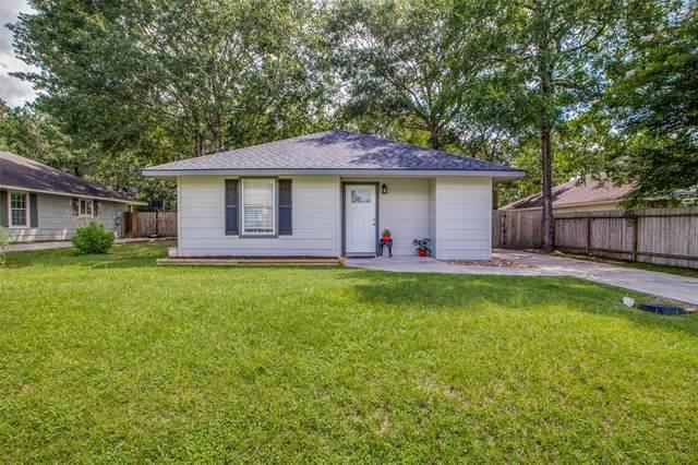 8860 E Buffalo Circle, Willis, TX 77378 (MLS #44144193) :: The Freund Group