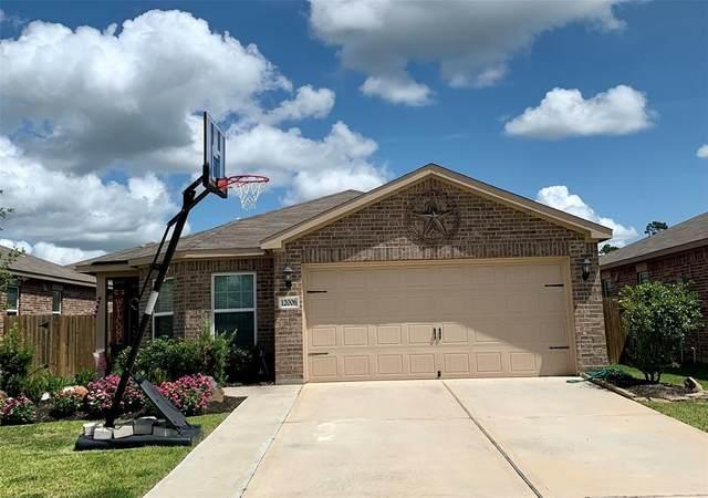12006 Powderhorn Lane, Pinehurst, TX 77362 (MLS #44529056) :: Michele Harmon Team