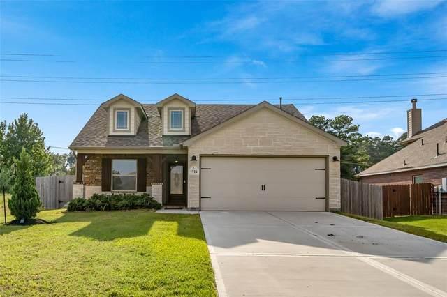 1724 Wandering Hills Road, Conroe, TX 77304 (MLS #44735086) :: NewHomePrograms.com