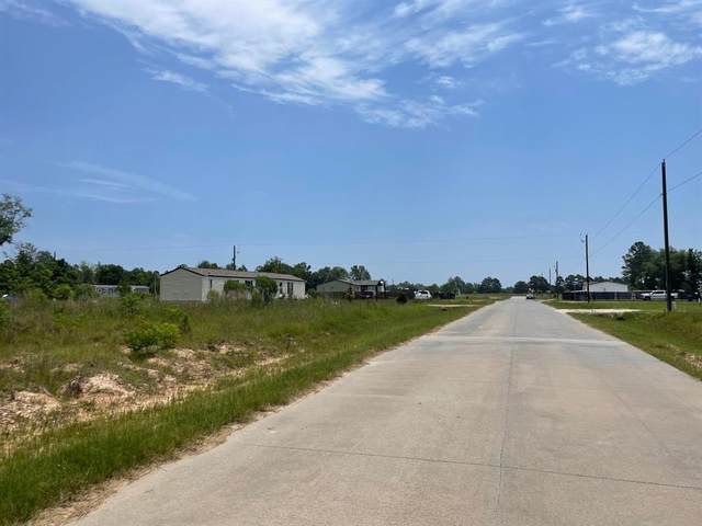 878 County Road 5027, Cleveland, TX 77327 (MLS #44752910) :: The SOLD by George Team