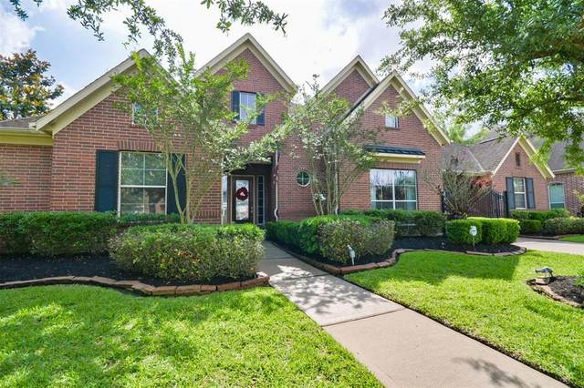 14014 Windwood Falls Lane, Humble, TX 77396 (MLS #45475590) :: The SOLD by George Team