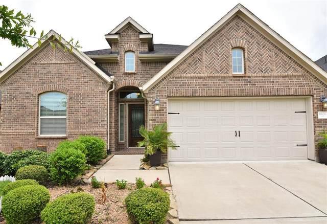 8806 Houston Falls Lane, Richmond, TX 77407 (MLS #45924880) :: Michele Harmon Team