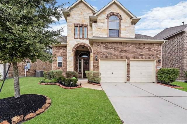 21348 Kings Guild Lane, Kingwood, TX 77339 (MLS #46133081) :: The Sansone Group