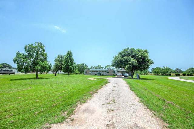 196 County Road 2286, Cleveland, TX 77327 (MLS #46842742) :: The SOLD by George Team